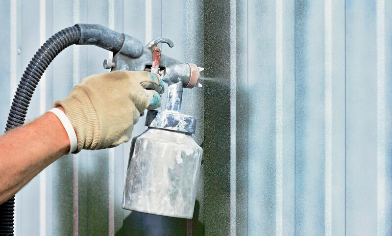 Photo close up of paint spraying gun